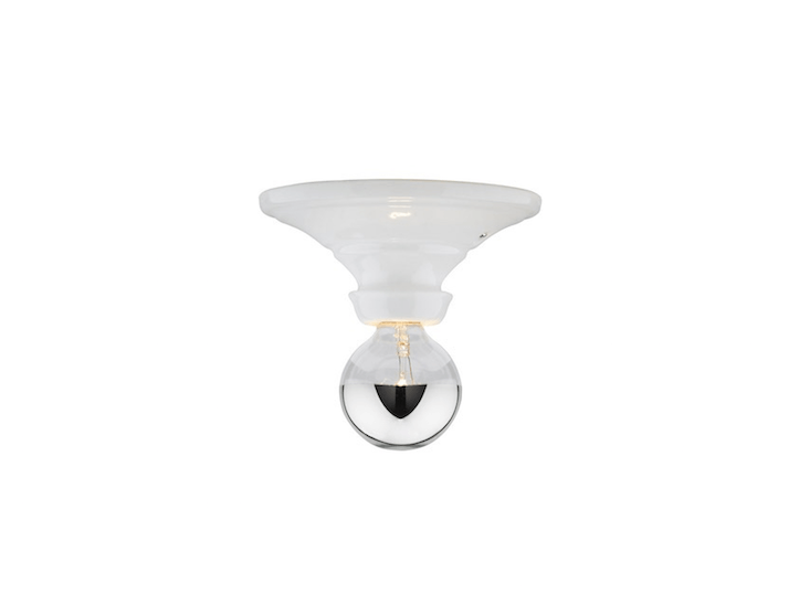 A Hannah Bare Bulb socket fixture is available with either a black or white porcelain base; rated for use in a damp spot, it is $9 from Rejuvenation.