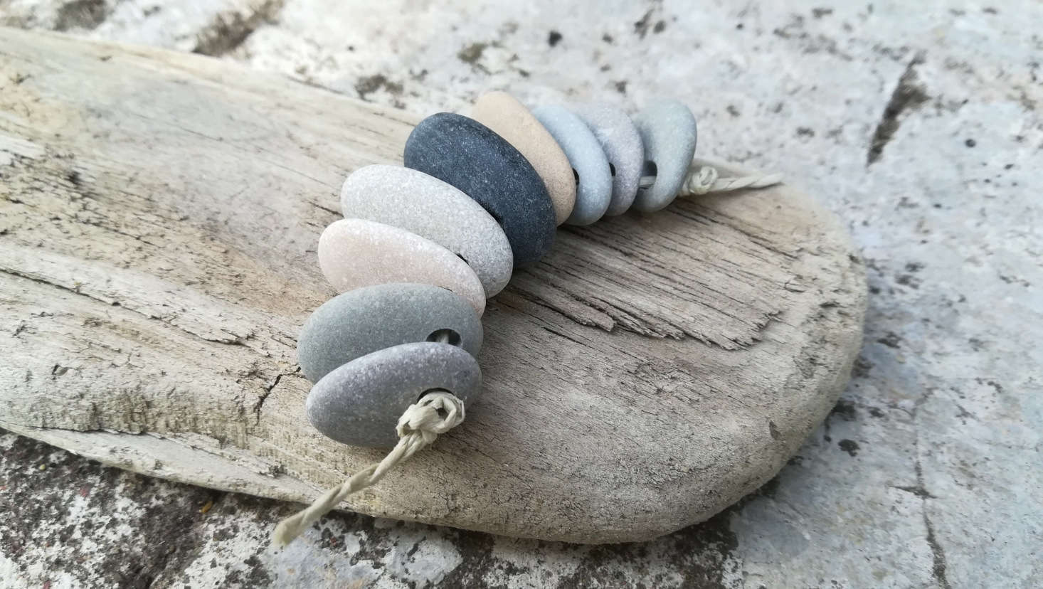 Don't have a diamond drill bit? You can order predrilled pebbles on Etsy. These Top-Drilled Sea Pebbles are sold by MixedCraftGoods; $7.29 for 9 stones.