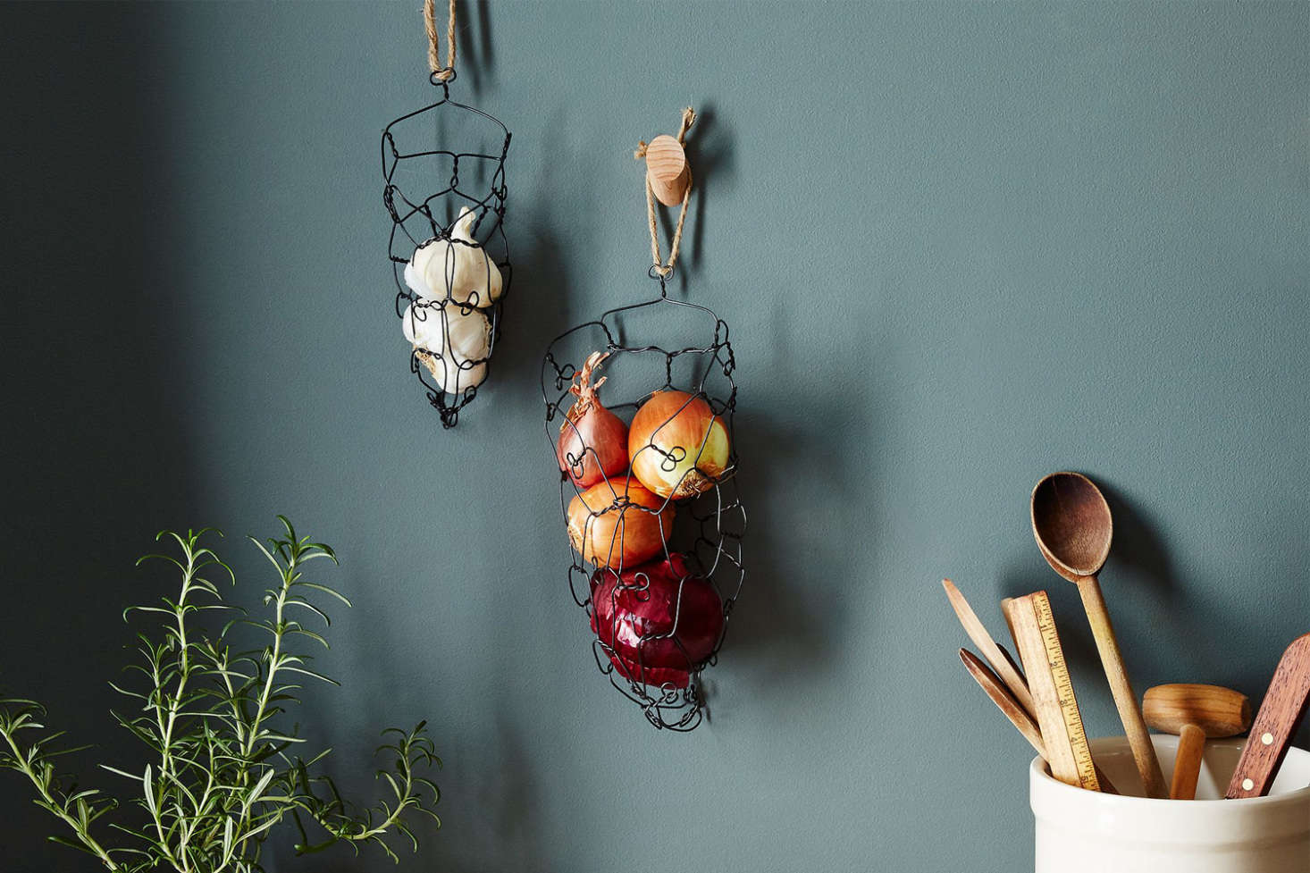 The Charest Studios Wall-Mounted Onion Garlic Basket is made of annealed steel wire and hangs on the wall; $30 to $69 at Food52.