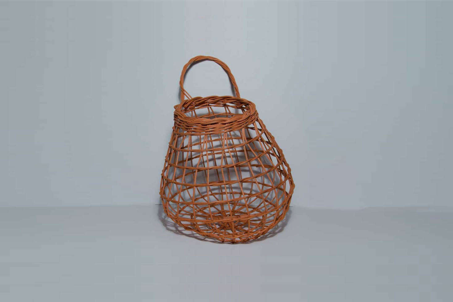 From Etsy seller Justa Bunch of Baskets, the Rust Onion Basket made of hand-dyed round reed, is $65.