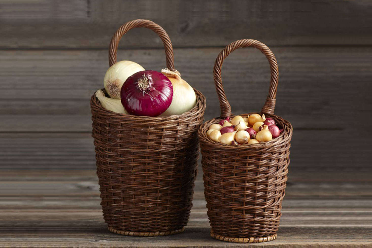 A set of two hand-woven rattan Onion Baskets (the tall one is 14 inches high, including its handle; the smaller one is 13½ inches) is $29.95 from Williams-Sonoma.
