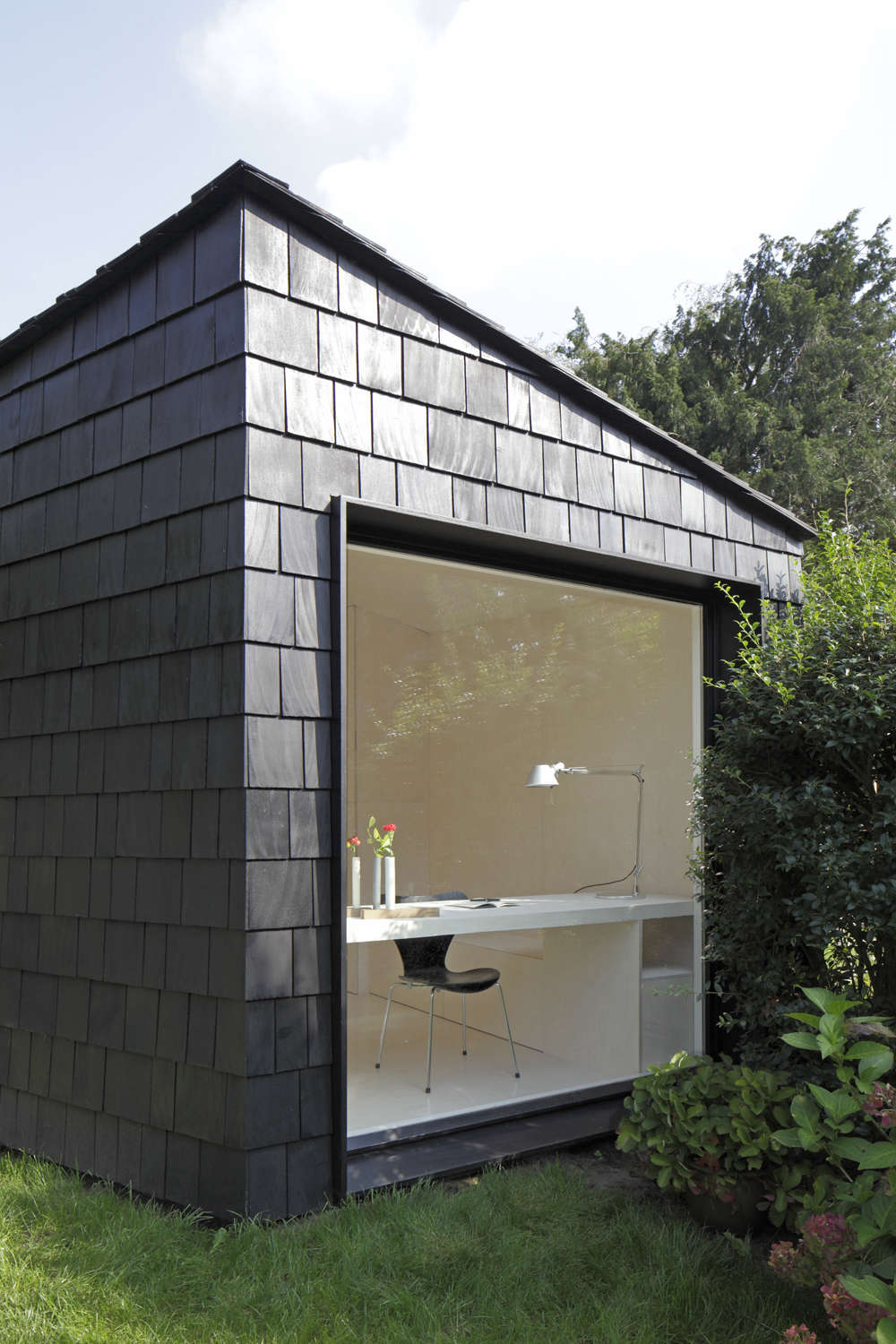 backyard guest house. Above: Two Thousand Black-stained Cedar Shingles Envelop The Building And Extend To Roof, Provide A Quiet Dramatic Backdrop For Backyard\u0027s Backyard Guest House