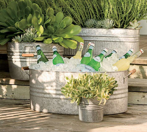 Outdoors Galvanized Planters From Pottery Barn Remodelista