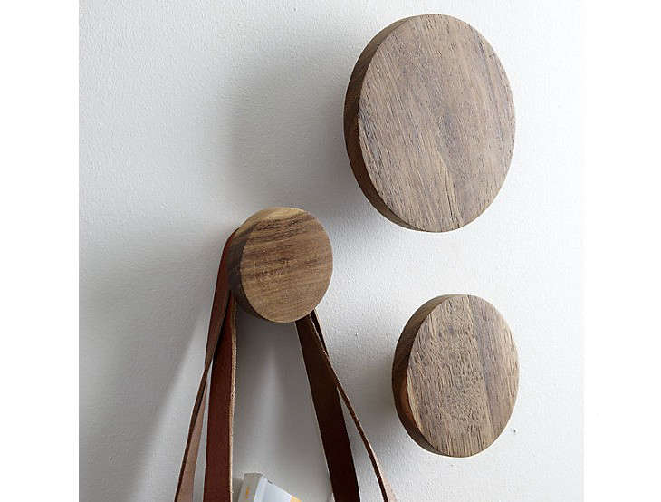 Above: With a rougher finish, Dot Coat Hooks made in India from reclaimed  sen wood have splits, cracks and knots; a set of three is $12.95 from CB2.