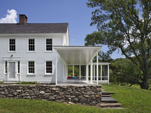 "For this house in Connecticut, Brooklyn's O'Neill Rose Architects used low-luster Benjamin Moore Brilliant White, which principal Devin O'Neill calls ""a standard that always looks good."" The firm worked with Donald Kaufman on the palette for the house and chose Donald Kaufman Color DKC-44 in semi-gloss for the porch and ceiling. Photography by Michael Moran, from Curb Appeal: Architects'  Favorite White Paints."