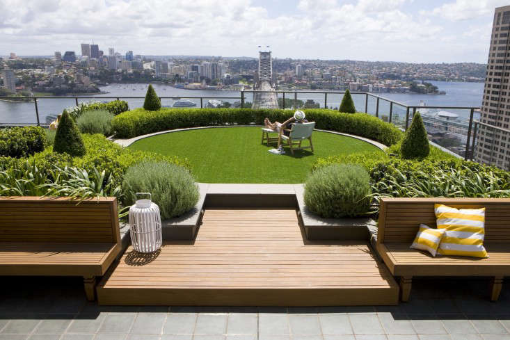 above secret gardens also created a dramatic circular lawn on a terrace overlooking the sydney harbour bridge the low maintenance artificial turf is