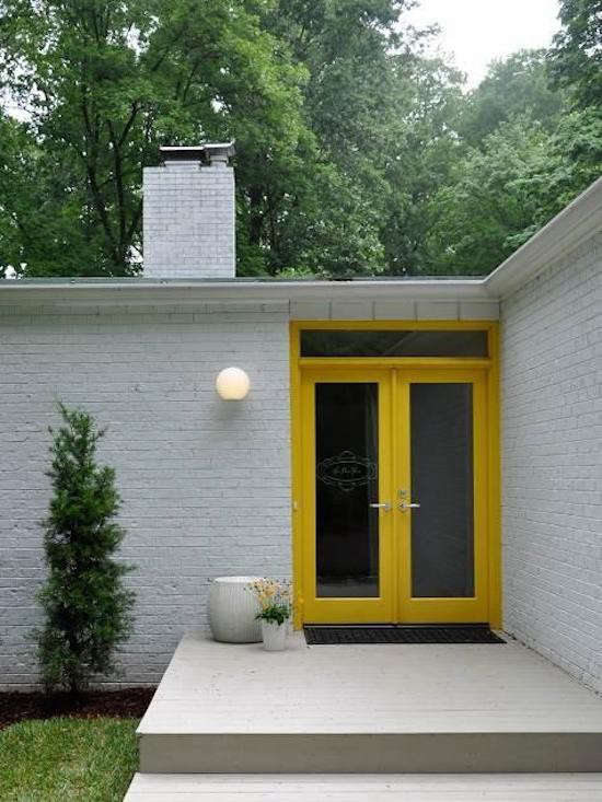 Outdoor Entry Lighting Hardscaping 101 outdoor entry lighting gardenista above a modernist entry with a bright yellow door and a single outdoor globe lighting fixture photograph via design sponge workwithnaturefo