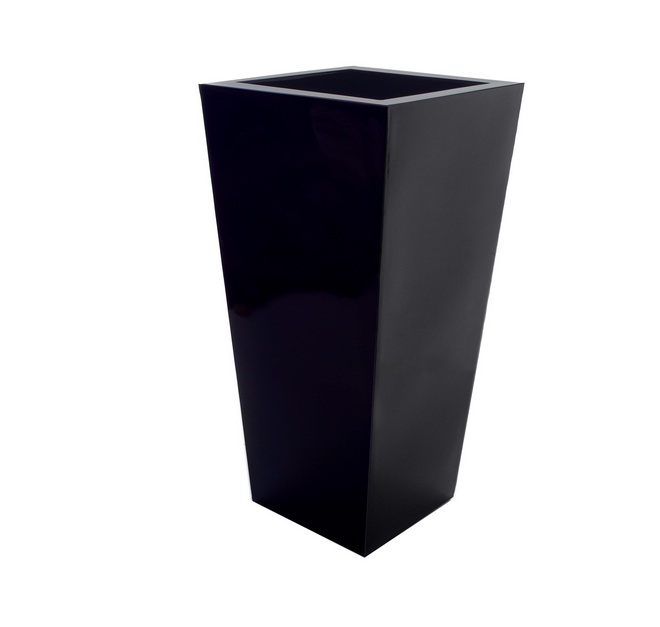 Above: For Both Indoor And Outdoor Use, A Tall, Tapered Plastic Serralunga  Kabin Planter Is $295 From All Modern.