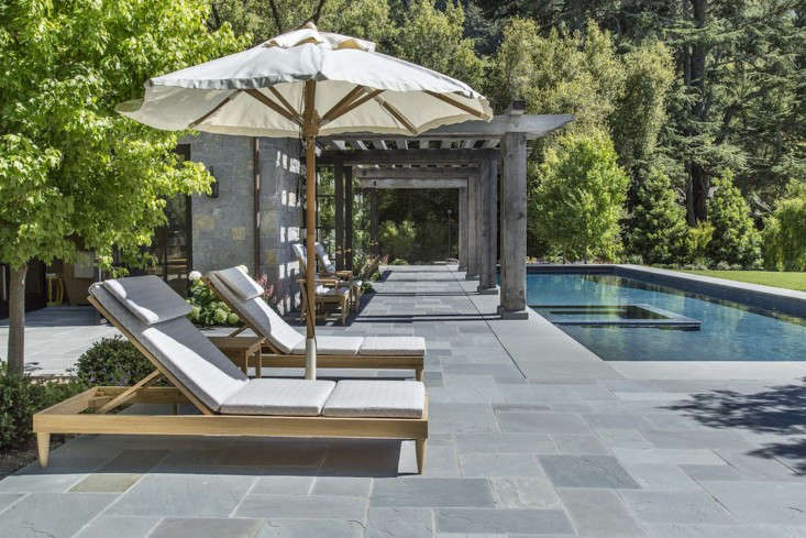 A pool surround, laid in an ashlar pattern, in Marin County, California; designed by Ken Linsteadt Architects.