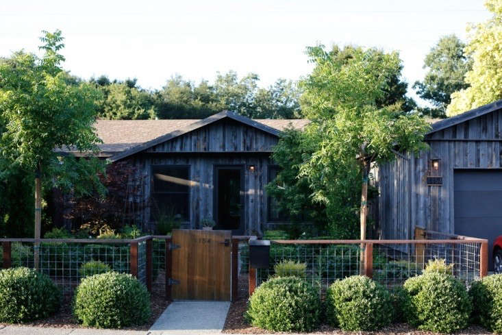 before and after a rustic facade adds curb appeal to a plain jane