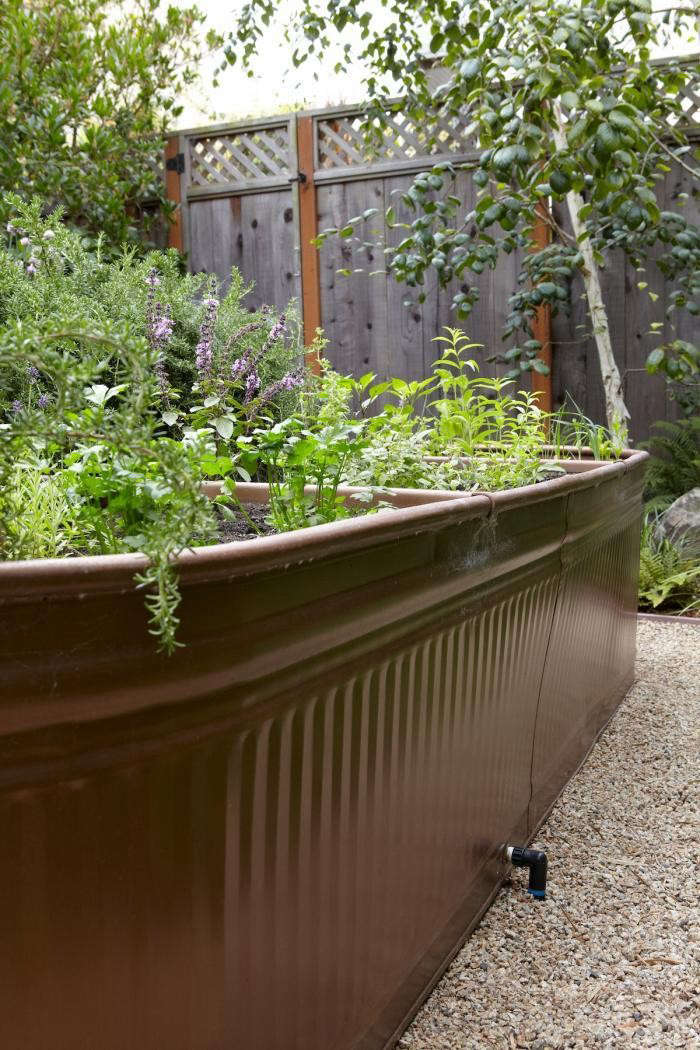An irrigation hose is attached through the trough's drainage hole. For step-by-step instructions, seeSteal This Look: Water Troughs as Raised Beds.Photograph byMarla Aufmuthfor Gardenista.