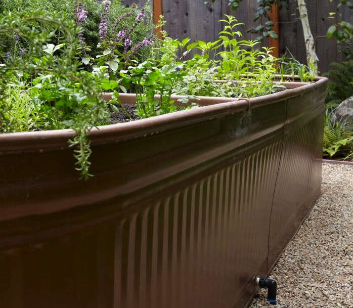 Steal this look water troughs as raised garden beds gardenista - Water garden containers for sale ...