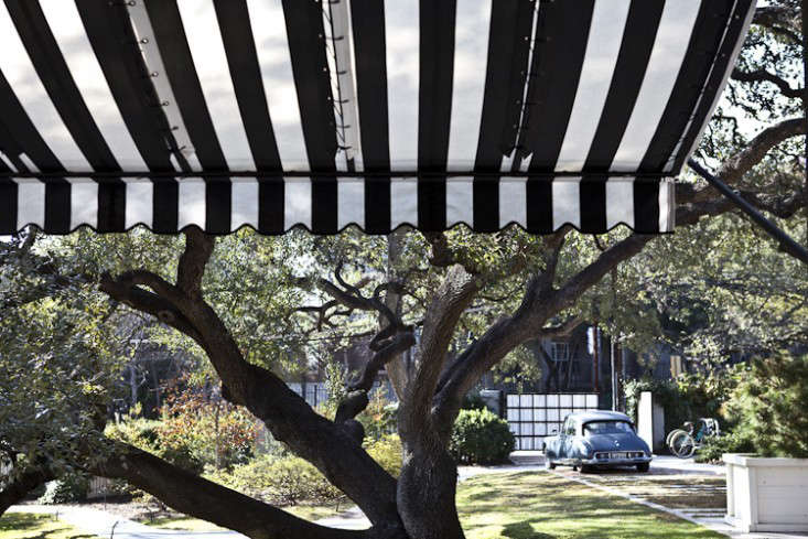 Above At the Hotel Saint Cecilia in Austin Texas an open-end striped awning with a shallow wave valence shades a courtyard. & 10 Easy Pieces: Window Awnings - Gardenista
