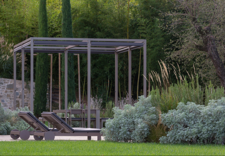 Silvery gray-green clouds of artemisia and feathery grasses soften the edge of a planting bed.Photography byDario Fusaro courtesy ofCristiana Ruspa. For more, seeLandscape Architect Visit: A Hazy Dreamscape in Northern Italy by Cristiana Ruspa.