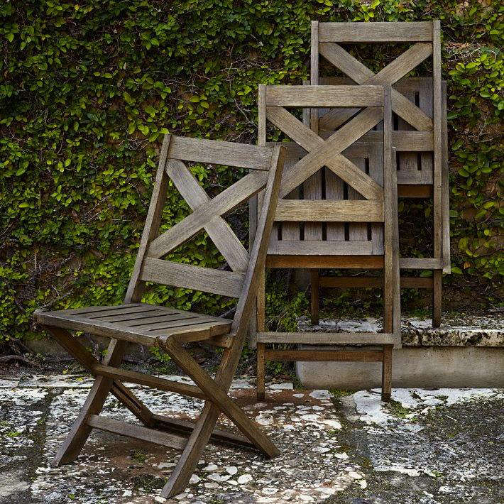 above new from west elm the jardine folding chair is made of tropical wood in a driftwood finish 198 for a set of two - Outdoor Folding Chairs