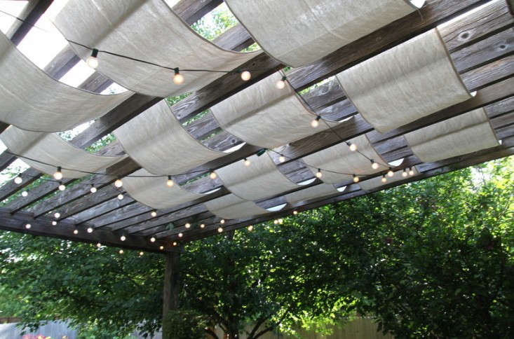 Spotted on the blog Anything Pretty: A genius idea for adding a bit of  shade to a simple wood pergola. All that's required: A couple of painter's  drop ... - DIY: Instant Painter's Drop Cloth Pergola - Gardenista