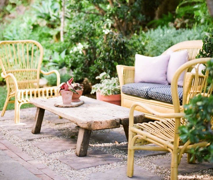 Rattan furniture does best in a covered area, but it's also fine in mild, dry climates. Photograph from Garden Visit: At Home with Jeweler Kathleen Whitaker in LA.