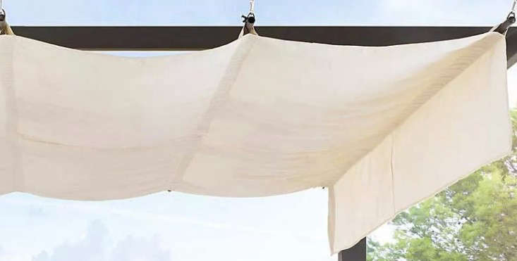 Above A Polyester Canopy Hangs From Hooks On The Pergolas Frame