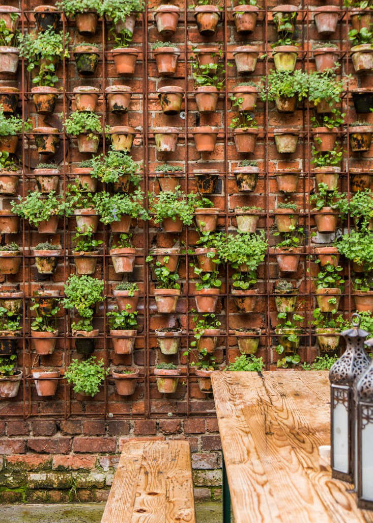 Design Sleuth: Vertical Garden Of Terra Cotta Pots - Gardenista