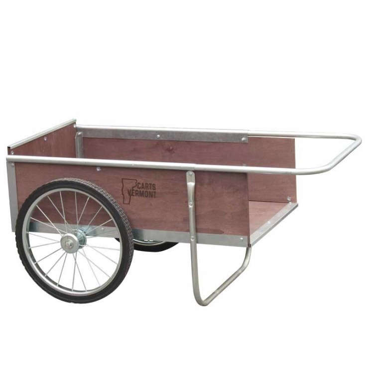 Above: With An Extra Wide Wheel Base And Sturdy Steel Frame, A Wooden Garden  Cart By Carts Vermont Can Haul Loads Easily Over Uneven Terrain.