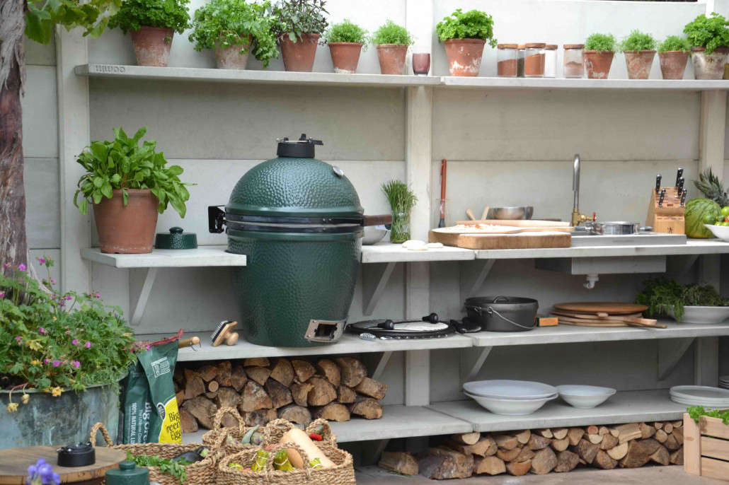 above wwoo in the netherlands offers modular outdoor kitchens that include the big green egg ceramic grill with an option of a pizza oven fireplace