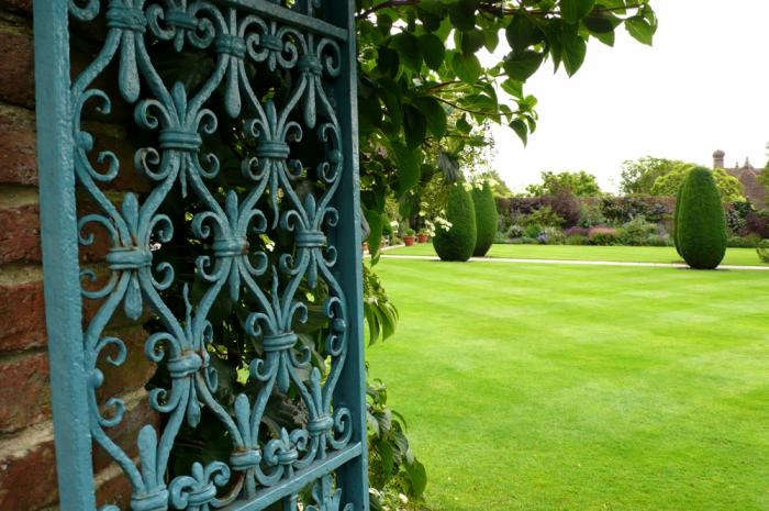 A Gate At Sissinghurst Castle, Painted A Lively Blue. This Color Would Have  Been