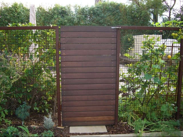 ... Gate Of Horizontal Boards Framed By A Hogwire Fence. Image Via  Environmental Concepts. For More Of Our Picks, See U201c10 Easy Pieces: Wooden  Garden Gates.u201d