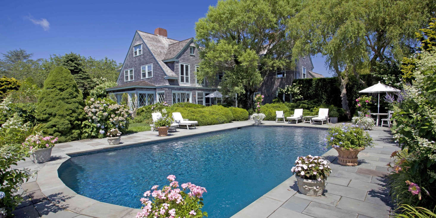 At Grey Gardens, where the swimming pool is surrounded by bluestone pavers, landscape designer Victoria Fensterer created a series of outdoor rooms that guests could discover as they wandered through the garden.