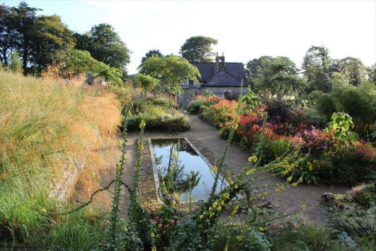 """Irish plantswoman June Blake used to be a jeweler, so it's perhaps no surprise that her garden, in the words of garden writer Fionnuala Fallon, """"is startling in its beauty like the spilt contents of a jewelry box."""" Photograph via VRBO."""