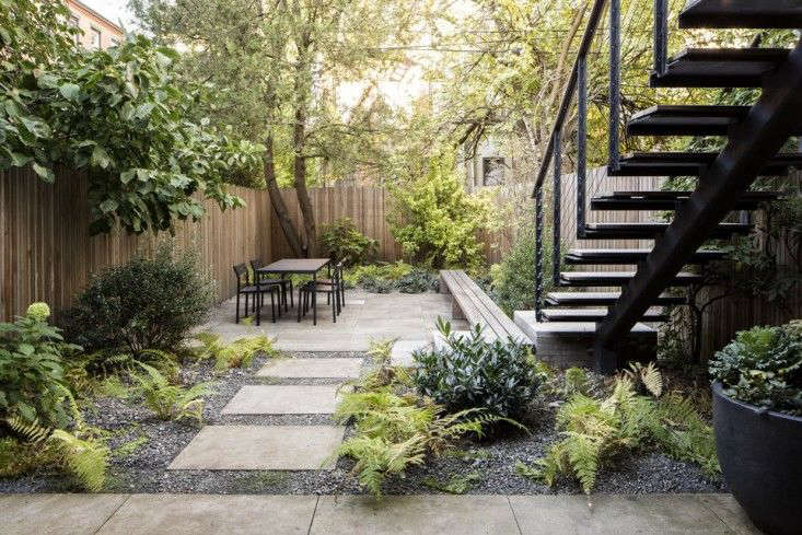in a brooklyn backyard garden designer brook klausing edged limestone pavers with crushed limestone dust