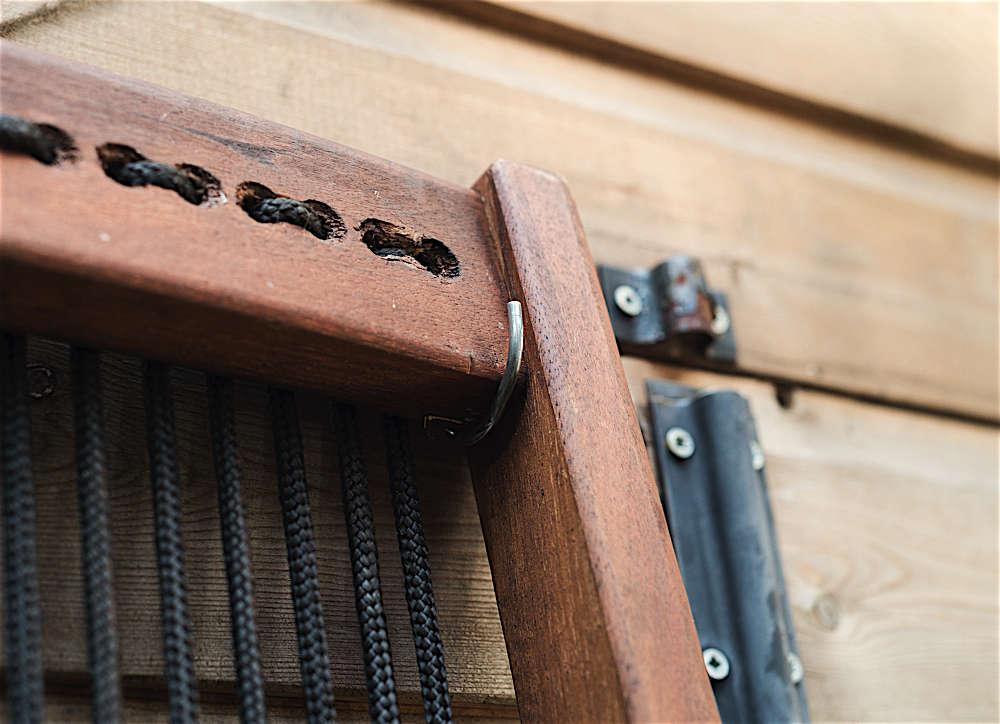 Christine Chang Hanway, London garden, Garden as exterior room, detail of Ikea Brommö chair hanging from garden shed, Matthew Williams | Gardenista