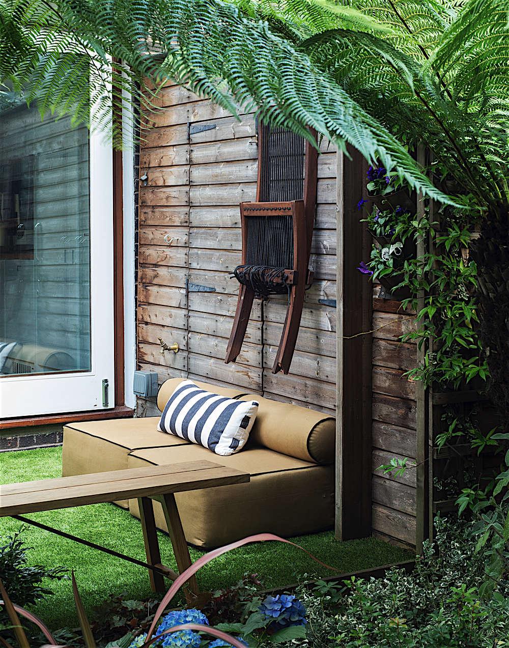 Christine Chang Hanway, London garden, Garden as exterior room, artificial grass, outdoor seating, garden shed, large tree fern, Matthew Williams | Gardenista