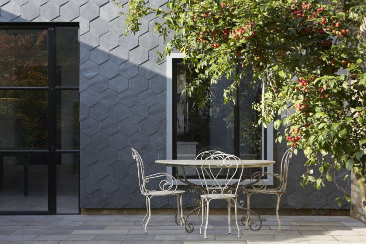 The thin legs on the wrought-iron chairs pose no problems on this patio with pavers. Photograph by Hufton & Crow for Gundry & Ducker, from Steal This Look: A House With Slate Shingle Siding.