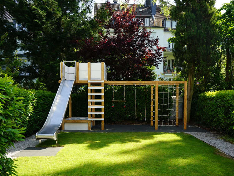 Above: The playground is constructed of wood, steel, and engineering  plastic (plus a few lengths of rope). play-structure-slide-gardenista - Children's Hour: The Ultimate Garden Playground - Gardenista