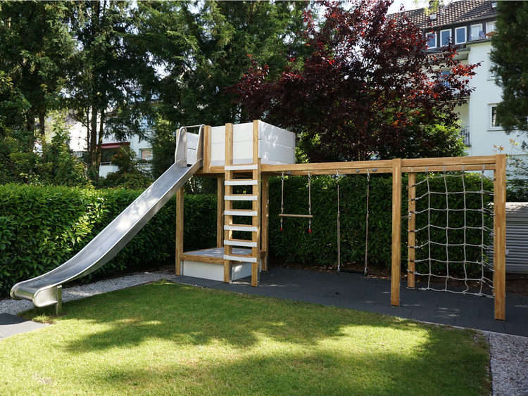 Above: In Addition To The Slide And Sandbox, The Playground Has Two Swings,  Two Bars, And A Rope Climbing Net Suspended From The Wooden Frame.