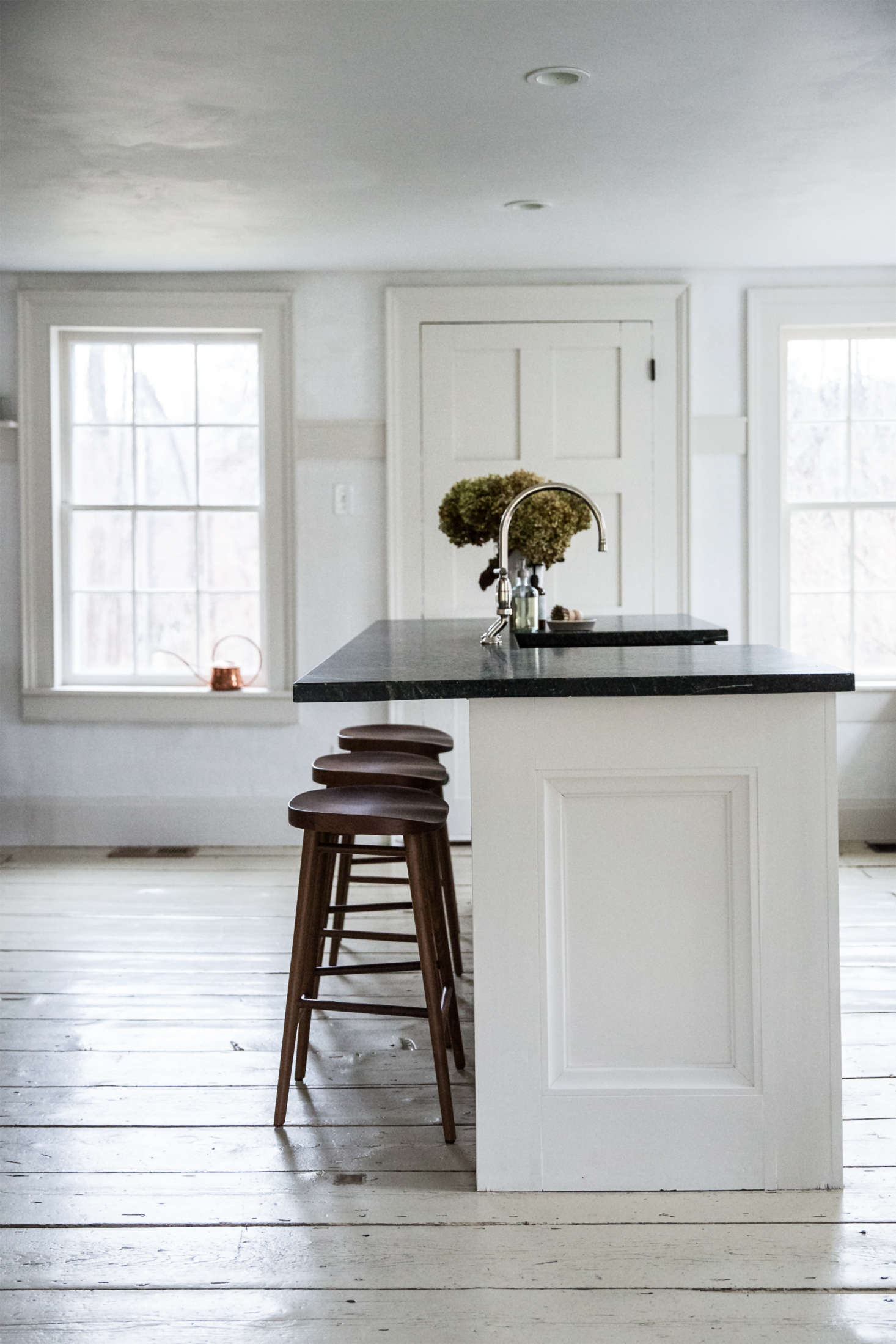 Billowy dried hydrangeas float above a soapstone kitchen sink. Photograph by Beth Kirby of Local Milk.