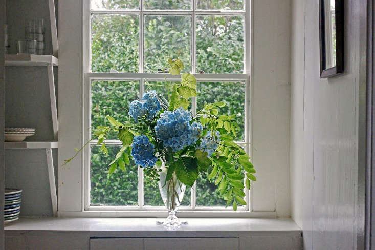Justine composed a stunning foraged bouquet out of hydrangeas, locust tree leaves, and grape vines. Photograph by Justine Hand, from Bouquet of the Week: Hydrangeas Gone Wild.