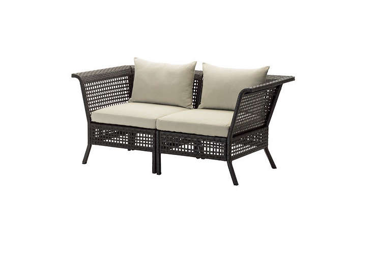 From Ikea, Kungsholmen Hållö outdoor seating collection includes a loveseat, a three-seater, and a sectional sofa. All pieces in the Ikea line have aluminum frames and polyester webbing. Ikea's Kungsholmen Hållö Loveseat with beige outdoor cushions is $260.