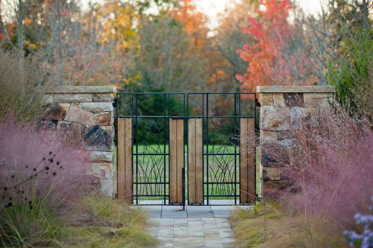 Photograph by Eric Piasecki/OTTOcourtesy ofNelson Byrd Woltz Landscape Architects. Planted on either side of a gate, Muhlenbergia creates a pleasingmirror image.