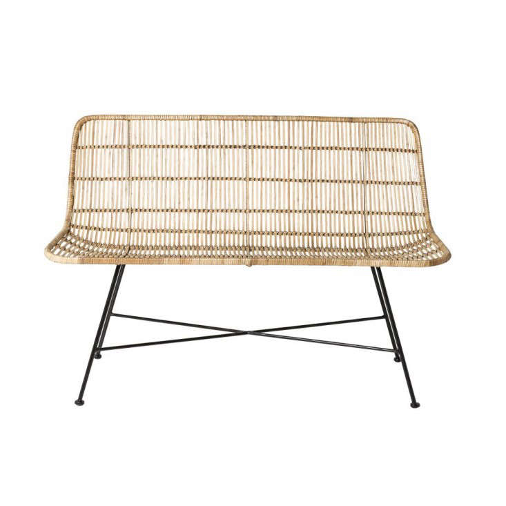 From Danish brand Bloomingville, a two-seater Natural Rattan Sofa is happiest on a covered porch or indoors rather than in direct sunlight. It measures 120 centimeters long (about 47.2 inches) and is €439 from Living & Co.