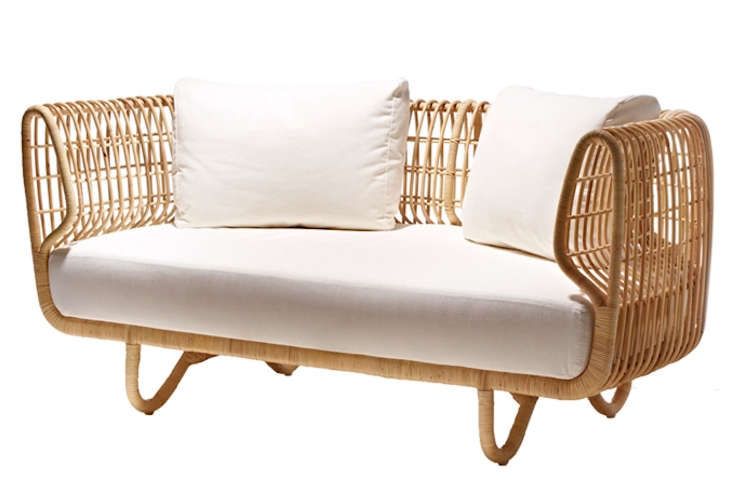 For sunrooms, screened porches, and covered spaces only: Alexa spotted a Nest Sofa from Danish designers Foersom & Hiort-Lorenzen. Made of sustainable rattan, it's $1,230 at Cane-Line. (The collection also includes the Nest Club Chair, Nest Lounge Chair, the Large Nest Footstool, and the Small Nest Footstool.)