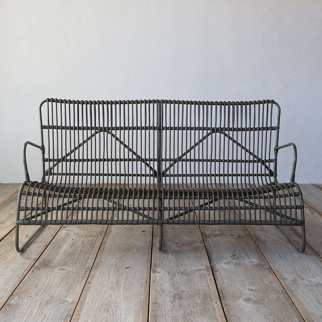 An Open Weave All Weather Wicker Sofa stands up to the weather, with polyester rattan woven around a powder-coated aluminum frame. It measures 58.1 inches long; $898 from Terrain.