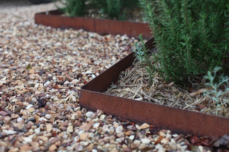 Steel edging is available with corrosion-resistant finishes or in unfinished form (as shown above, from Skemah).