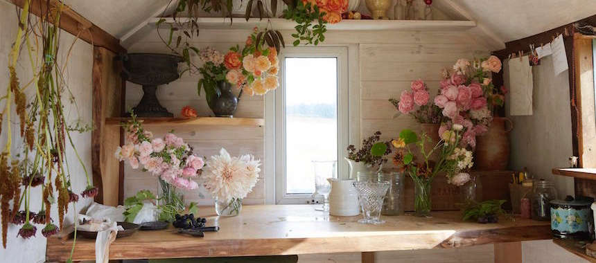 "Shropshire, UK-based florist Tammy Hall has a small studio in a former shepherd's hut ""rescued from a field at the top of the farm where it had been for years and years,"" she says. ""It now sits at the top of my field and is my quiet thinking space."" Photograph by Britt Willoughby Dyer."