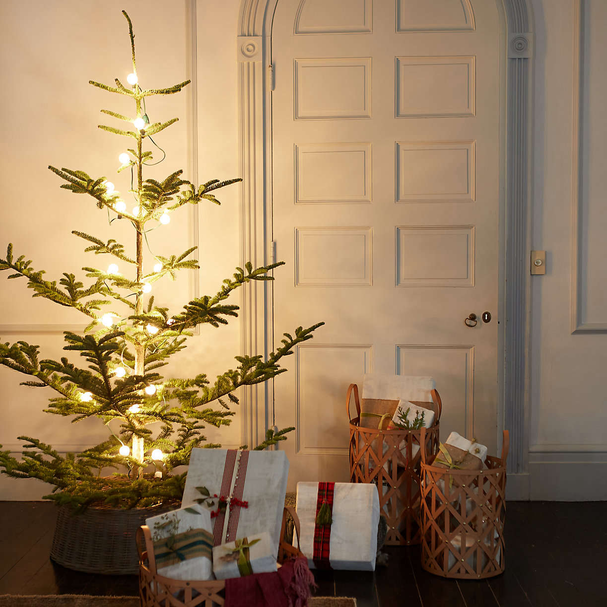 noble-fir-christmas-tree-with-gifts-leather-baskets-from-terrain