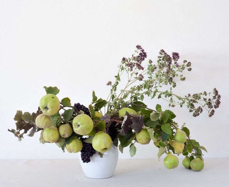 Roebuck is also a champion of enlisiting fruit in foraged arrangements. Here she uses no flowers at all, instead employing branches laden with wild apples, grapevines, and thyme to give her composition color and texture. Photograph by Matthew Williams for Gardenista, from Louesa Roebuck&#8