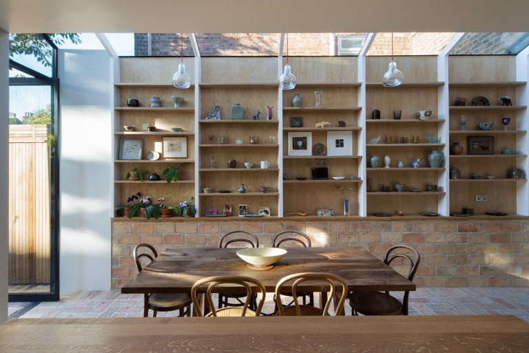 Got open shelving? Treat them like a shopkeeper would and think of them as opportunities to both store and display. Photograph courtesy of Neil Dusheiko Architects, from Kitchen of the Week: An Architect's Labor-of-Love Kitchen, Art Gallery Included.