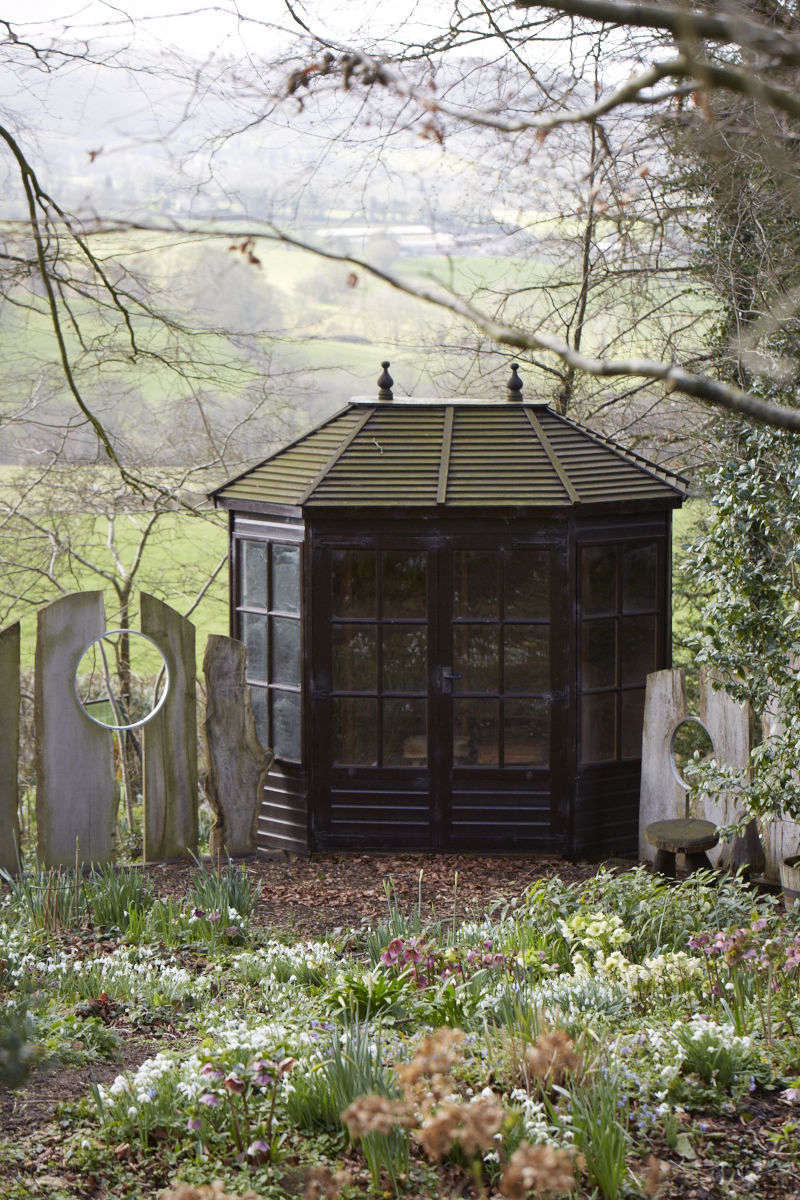 Many of the flowers are framed by the unusual fence made from driftwood and bicycle tire rims, with which Celia fell in love at the Malvern Flower Show.