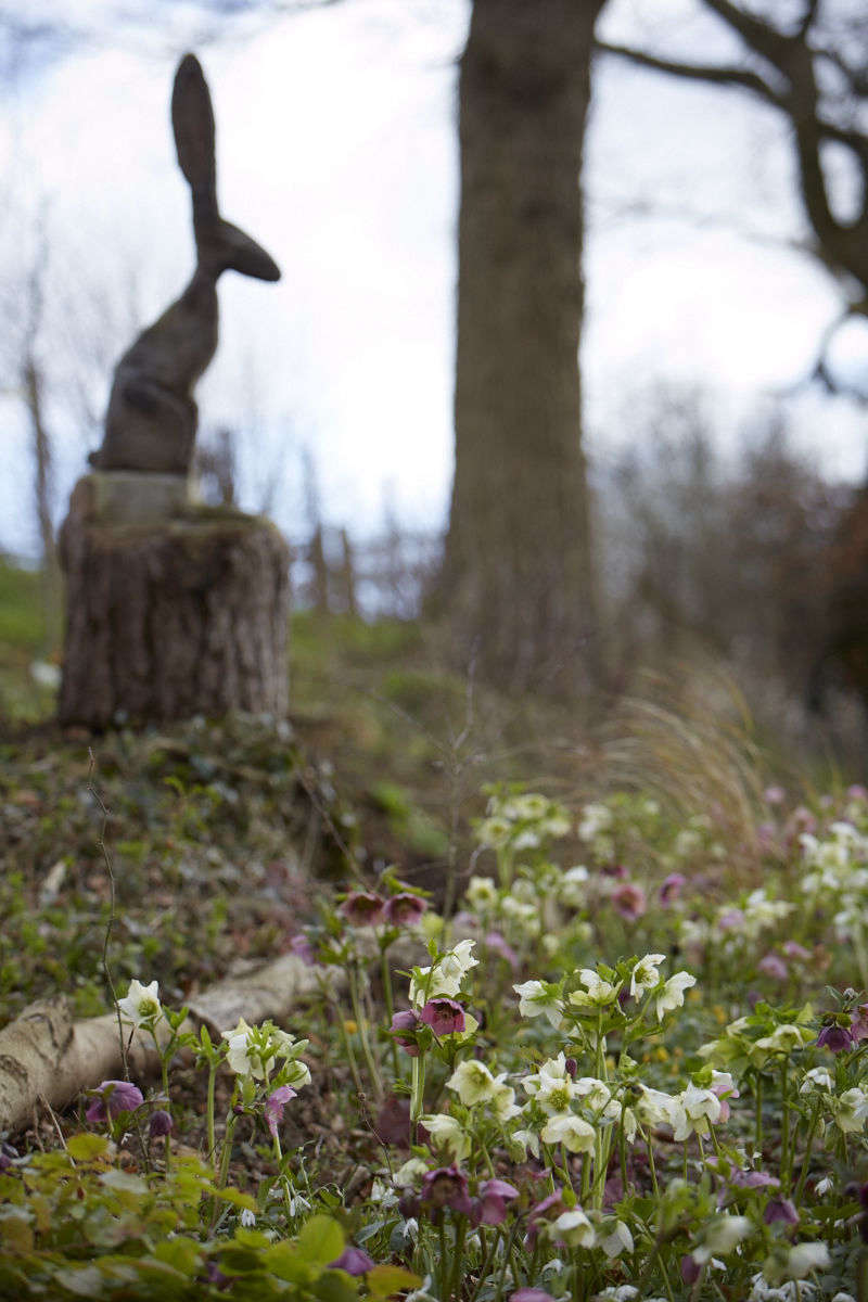 Watching over the colorful carpet is a carved wooden hare created by the tree surgeon Jasper Drake.