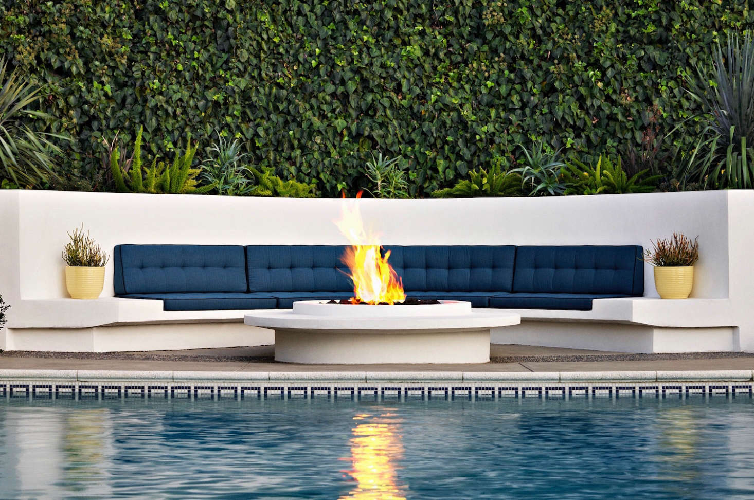 "What's nice about a fire pit is that people can sit all the way around them—an outdoor fireplace generally doesn't allow that,"" says Judy. Photograph by Tom Mannion."